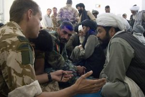 The OC of Bravo Company Major Dan Cheeseman RM talks to an Elder at the weekly (Shura) gatering of Elders at Sangin. Nov 2007