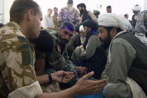 The OC of Bravo Company Major Dan Cheeseman RM talks to an Elder at the weekly (Shura) gatering of Elders at Sangin. Nov 2007
